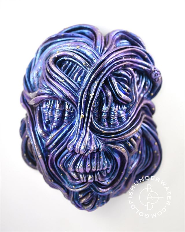 Stardust Dreamer .This one is finished with a ghost chameleon pigment that shifts between blue and purple depending on how the light hits it. Ghost chameleons are transparent and show up best on black. I based the sculpture in black and used silver to create highlights. I also added some transparent washes and holographic glitter over the chameleon pigment to give it extra sparkle.
